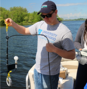Graduate Student testing water quality for Scugog Lake Stewards